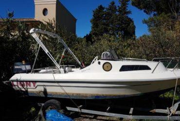 Barca semicabinato Ligny, carrello, motore Yamaha 25/50 €.1800